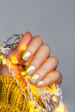 Perfect minimalistic manicure with geometry in trendy colors 免版税图像