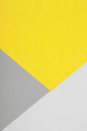 Paper background in two trendy colors - yellow and gray. Demonstrating colors of the year