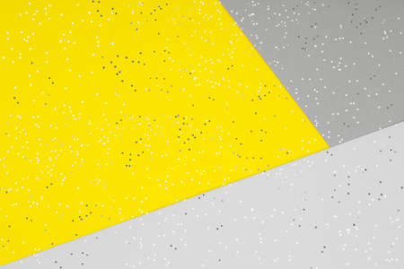 Paper background in two trendy colors - yellow and gray. Demonstrating colors of 2021 year