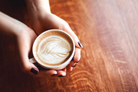 Coffee in woman hands