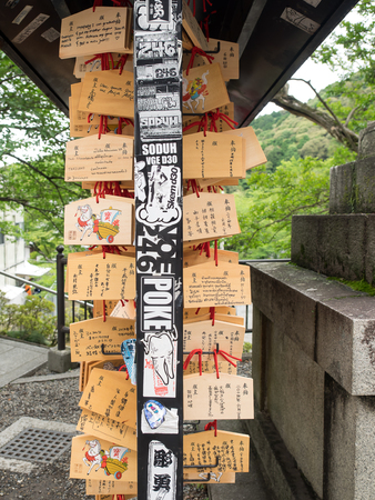 happieness: Kyoto, Japan - June 28, 2014 :  dirty Horse wooden prayer tablets at Kiyomizu dera Kyoto (The Horse year). Pray for happieness good life healthy peace luck by write praying word in wooden. Editorial