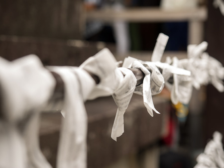 charms: Kyoto,Japan - June 21, 2014 : paper fortune charms hanged on a line in Kiyomizu temple. Stock Photo