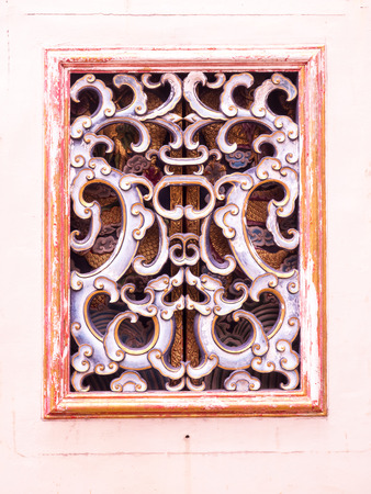 wood carvings: Ayutthaya Thailand  Oct  23 2014 : Chinese Traditional wood carvings window at Wat Phananchoen Stock Photo