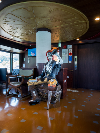 coffer: Sasebo japan  Apr 9 2015 : zombie skeleton with a gun a bottle of wine and a coffer in the ship of Saikai Pearl Sea Resort Editorial