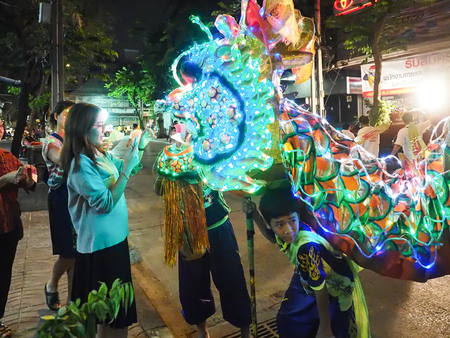 next year: Bangkok, Thailand - October 20, 2015 : women put a money in dragon mouth for luck in next year.