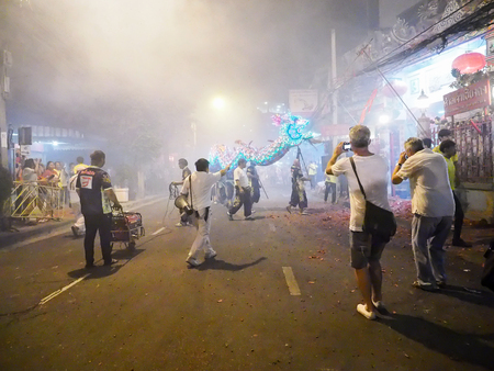 foreigner: Bangkok, Thailand - October 20, 2015 : touries foreigner take a picture of dragon in vegetarian festival.