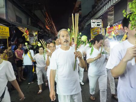 sue: Bangkok, Thailand - October 20, 2015 : Worshippers take part in a procession from Saan Jao Joe Sue Gong temple during the annual Vegetarian Festival