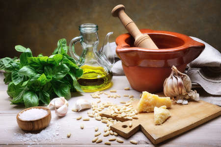 Basil pesto with pine nuts, garlic, parmesan cheese and extra virgin olive oil. Archivio Fotografico