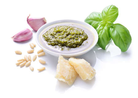 Genoese pesto sauce and ingredients isolated on white background. Archivio Fotografico