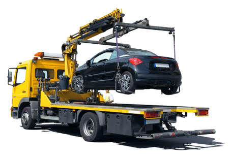 An illegally parked car towed away from the tow truck. Isolated on white background.