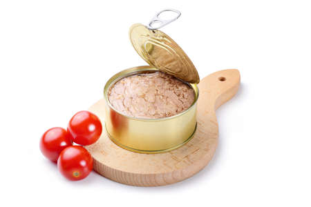 Canned tuna in olive oil with tomatoes and chopping board isolated on white background.