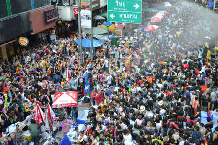 watergun: A lot of people in songkran festival at silom road. Everybody hold a water gun and start fight. Editorial