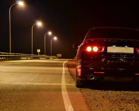 black car on the road at night. sport car