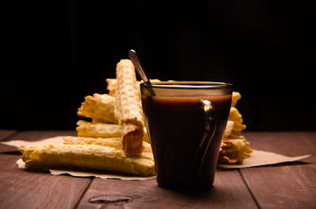 tubular wafer. waffles on wooden boards. hot chocolate Stock Photo