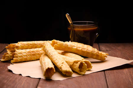 tubular wafer. waffles on wooden boards. hot chocolate Stock Photo