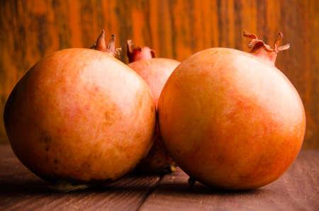 juicy pomegranate on wooden boards. ripe pomegranate on wooden boards.