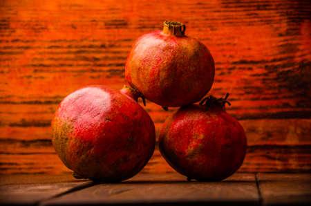 ripe pomegranate on wooden boards. juicy pomegranate on wooden boards. Stock Photo