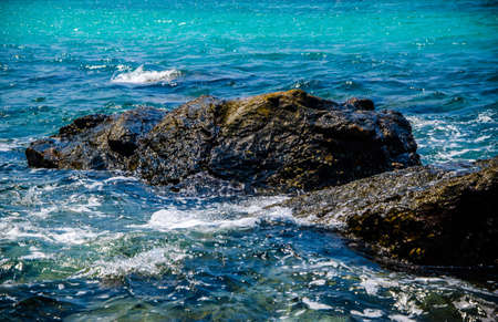 Ocean waves breaking on the rocks on the shore