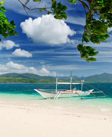 Tropical sea landscape. Boat on the beach.