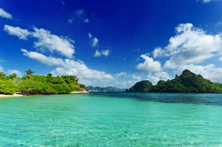 tranquil scene: Tropical beach with blue sky. Stock Photo