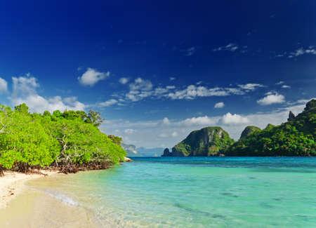 Tropical beach with blue sky. photo