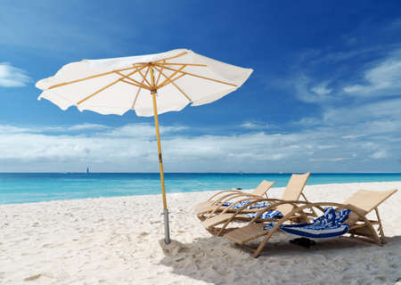 Chairs on white sand beach. Stock Photo