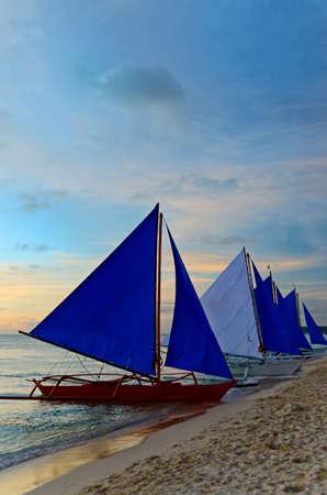 Sailboat against a orange sunset. Stock Photo - 9313126