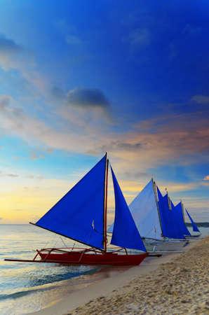 Sailboat against a orange sunset. Stock Photo - 9313801