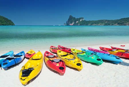 Colourful kayaks on the beach.  photo