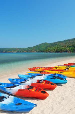 Colourful kayaks on the beach.  photo