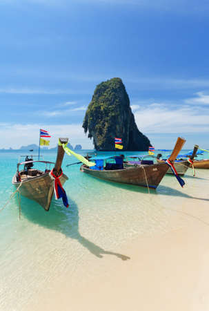 Thai traditional boats on Railay Beach, Krabi. photo