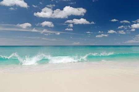 Tropical white sand beach and blue sky. Stock Photo