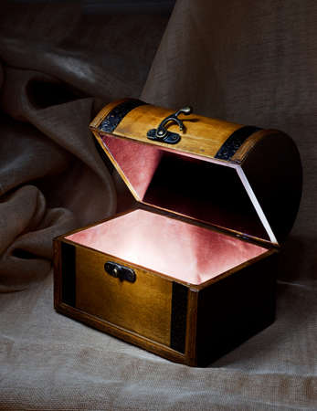 safety box: Wooden chest with light from inside.