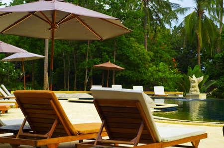 porch scene: Desk chair in tropical spa resort.