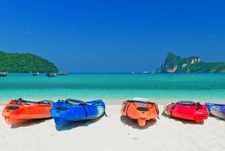 phi phi island: Colourful kayaks on the beach. Phi Phi island. Stock Photo