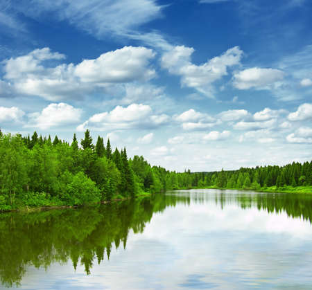 Silent lake near green forest. Stock Photo - 9615541