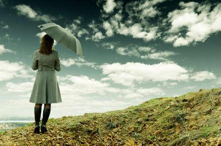girl in rain: Young woman with black umbrella.