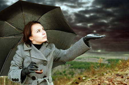 umbrella rain: Young woman with black umbrella.
