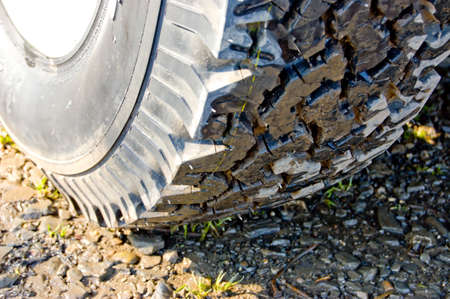 new tire in the mud Stock Photo - 9883474
