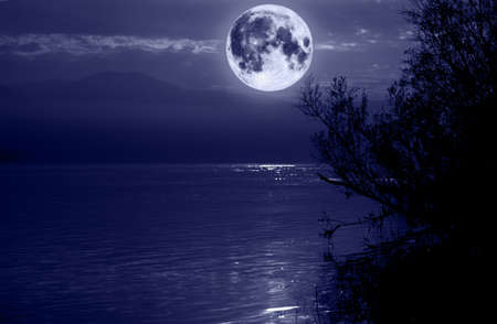 big blue moon over water photo