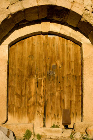 old wood door in evening sunlight photo