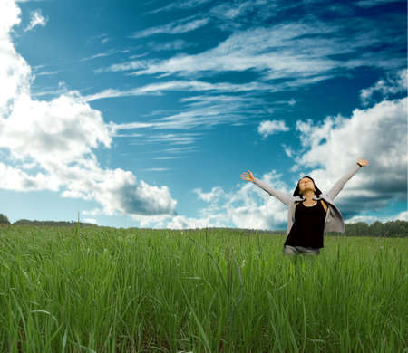worship praise: beautiful woman enjoy in meadow