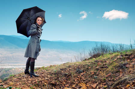 Young woman with black umbrella. Stock Photo - 9873364