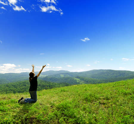prayer: Young woman enjoying the fresh air. Stock Photo