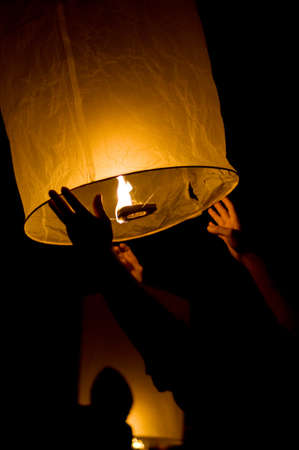 Traditional candle lantern in hands.  photo