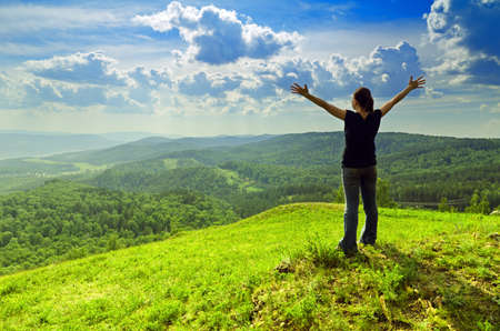 arms  outstretched: Young woman enjoying the fresh air. Stock Photo