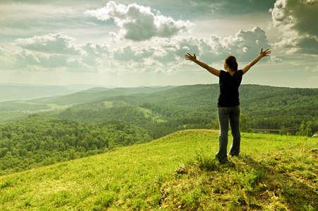 Young woman enjoying the fresh air. photo