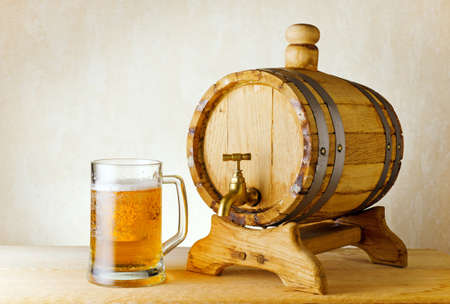 beer and barrel on the wood table. Stock Photo - 10658440