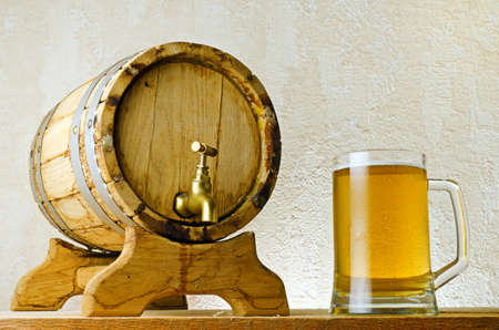 Beer and barrel on the wood table. Stock Photo - 10755063