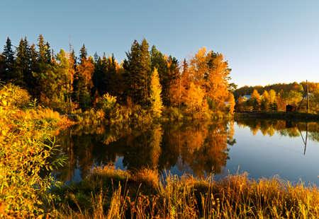 Lake in sunset rays. Autumn landscape. Stock Photo - 10755066